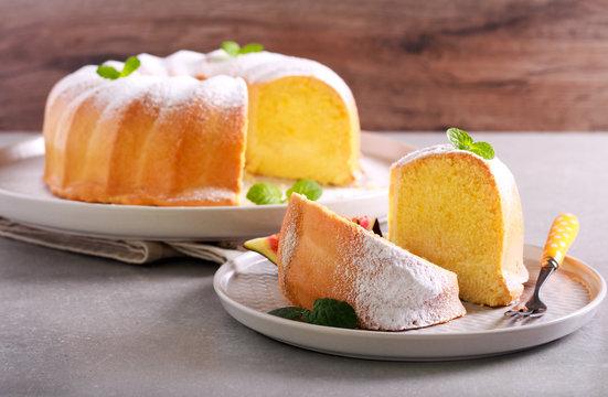 Lemon sponge ring cake with icing sugar