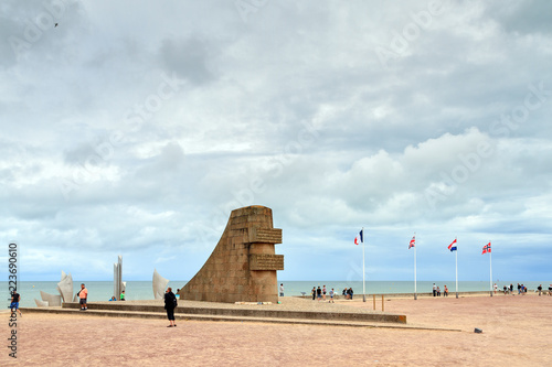 Tourists Visit The D Day Monument On Omaha Beach In Normandy France