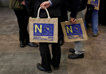 Delegates hold bags during the UKIP party conference in Birmingham