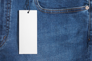 Blue jeans with blank white price label tag