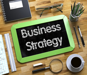 Business Strategy - Text on Small Chalkboard. 3d.