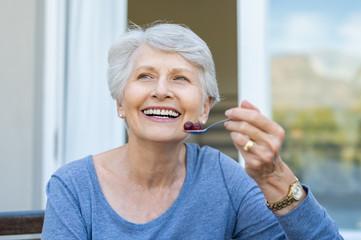 Senior woman eating fruit