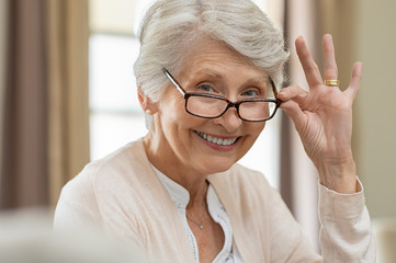 Senior woman holding eyeglasses