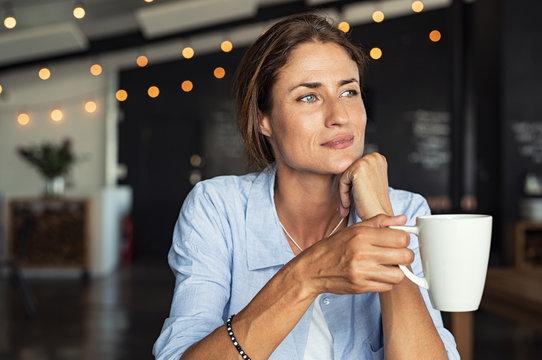 Mature woman drinking coffee