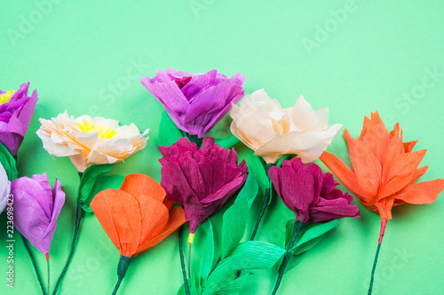 tools making crepe paper flowers green background