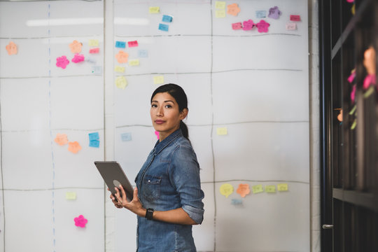 Female executive planning business strategy