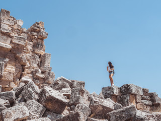 Ruins of ancient Hierapolis with tourist Pamukkale, Denizili, Turkey