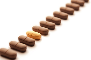 Medical pills in a row close up