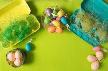 Eco-friendly packaging with decorative sisal and colorful eggs. Close-up photo, macro.  Easter background. Food concept
