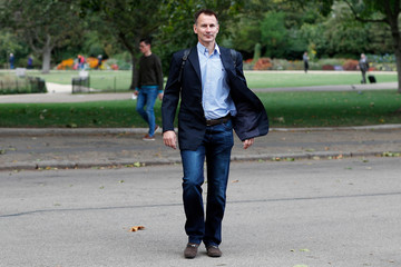 Britain's Foreign Secretary Jeremy Hunt walks towards the Foreign Office in London