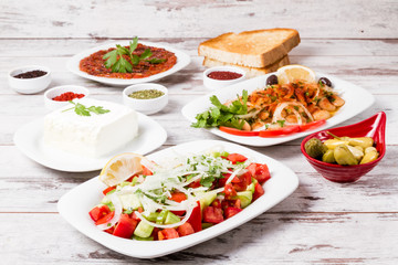 Various Turkish Appetizers from Onion, Tomato, Lettuce, Pickle, Yoghurt on White Wooden Background