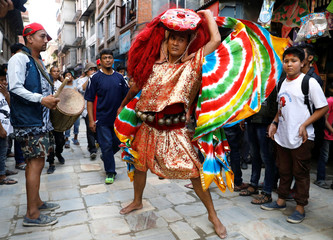 A dancer wearing a mask of Lakhey performs a traditional mask dance during the Indra Jatra festival in Kathmandu