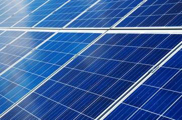 Close-up view of blue solar panels. Renewable energy.