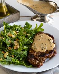 steak with arugula and green peppercorn sauce