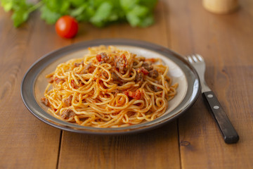 Spaghetti bolognese pasta with tomato sauce and minced meat. Homemade healthy italian pasta on wooden background