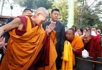 Tibetan spiritual leader the Dalai Lama gestures as he arrives for his visit to the Tibet Institute Rikon in Rikon