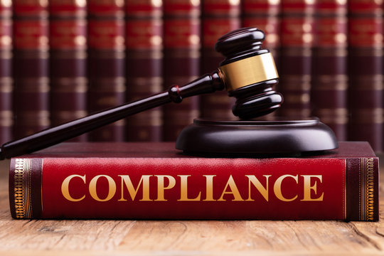 Judge Gavel And Soundboard On Compliance Law Book