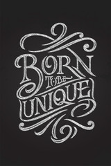 Lettering with chalk BORN TO BE UNIQUE on a chalkboard. Vector illustration for posters, banners, for printing on notepads and sketchbooks. Handmade typography.