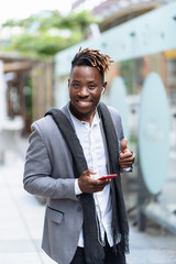Young african american man success sign doing positive gesture with hand, thumbs up smiling and happy