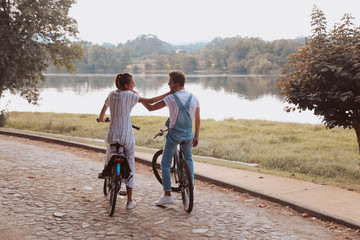 Romantic couple riding bicycles