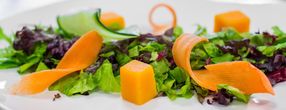 Salad preparation on chef's table