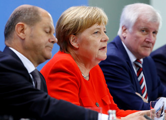 German Finance Minister Olaf Scholz, Chancellor Angela Merkel and Interior Minister Horst Seehofer address a news conference following the so called a housing summit on rising rents in many German cities