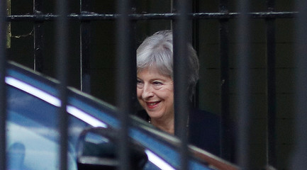 Britain's Prime Minister Theresa May leaves via the back entrance of 10 Downing Street in London