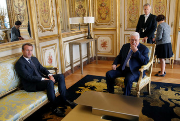 French President Emmanuel Macron meets Palestinian President Mahmoud Abbas at the Elysee palace