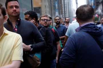 People wait in line for the Apple iPhone Xs Max, iPhone X and the Apple Watch Series 4 to go on sale at the Apple Store in Manhattan, New York