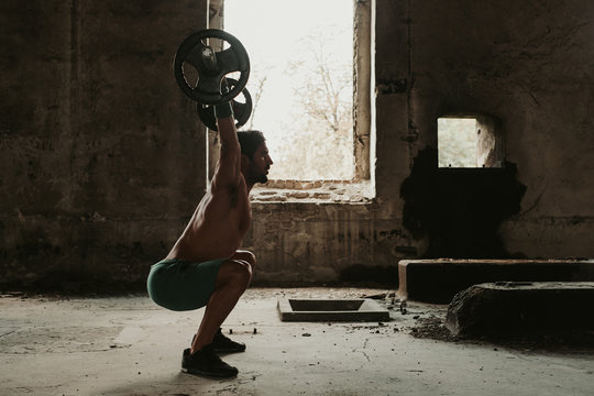 Crossfit male athlete in snatch position