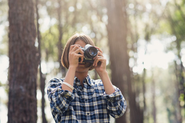 Young tourists taking pictures in the forest ,The concept of tourism