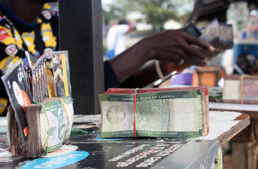 Liberian banknotes are pictured at a money changer's stand in Monrovia
