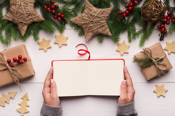 Woman is reviewing photo album on Christmas