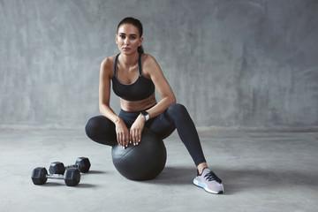 Sports Woman In Fashion Sportswear Sitting On Fitness Ball