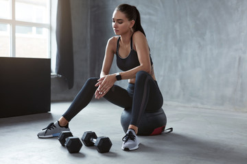 Woman In Black Stylish Sports Wear Sitting On Fitness Ball