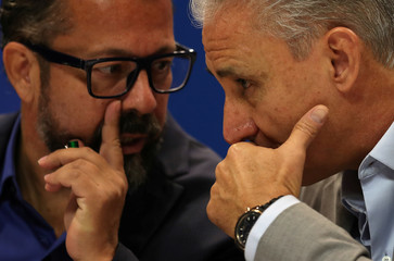 Brazilian national team head coach Tite talks with his assistant Cleber Xavier during a news conference in Rio de Janeiro