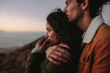 Fototapeta Beautiful couple looking at view from mountain obraz