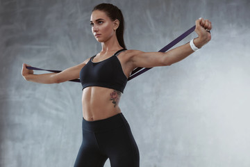 Sports Woman In Fashion Sportswear Exercising With Elastic Band