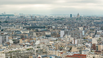 Aerial panorama above houses rooftops in a Paris timelapse