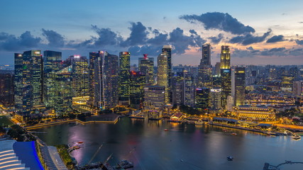 Printed kitchen splashbacks Australia A view of Singapore business district skyscrapers at evening with water reflections day to night timelapse
