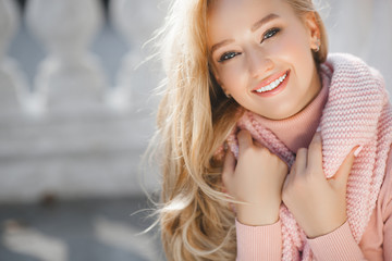 Close up portrait of young beautiful woman outdoors