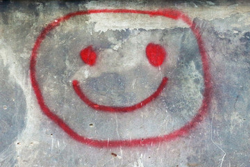 The abstract image of a smilie on a wall.