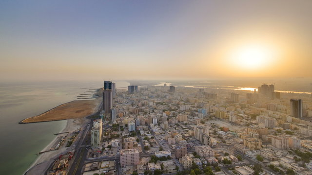 Sunrise and morning with Cityscape of Ajman from rooftop timelapse. Ajman is the capital of the emirate of Ajman in the United Arab Emirates.
