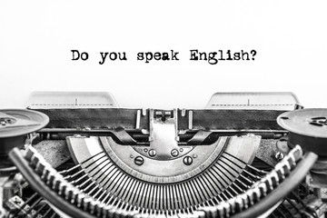 Do you speak English? typed text on a Vintage Typewriter, old paper, closeup. Education, training, school, foreign language