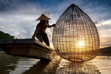 Fishermen fishing in the early morning golden light,fisherman fishing in Mekong River ,Thailand,Vietnam,myanmar,Laos