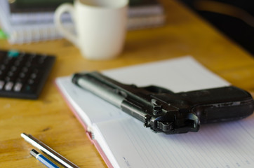The gun on the desk of a businessman
