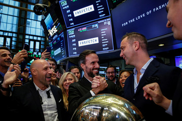 Online fashion house Farfetch's CEO Jose Neves is congratulated during his company's IPO at the NYSE in New York