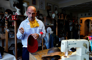 Belgian hat-designer Elvis Pompilio poses in his workshop in Brussels