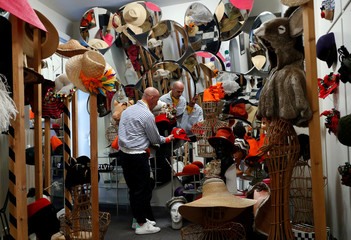 Belgian hat-designer Elvis Pompilio poses with hats in his workshop in Brussels