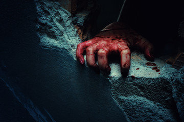 Horror Scene with bloody hand of evil is coming from a dark hole. Wall mural